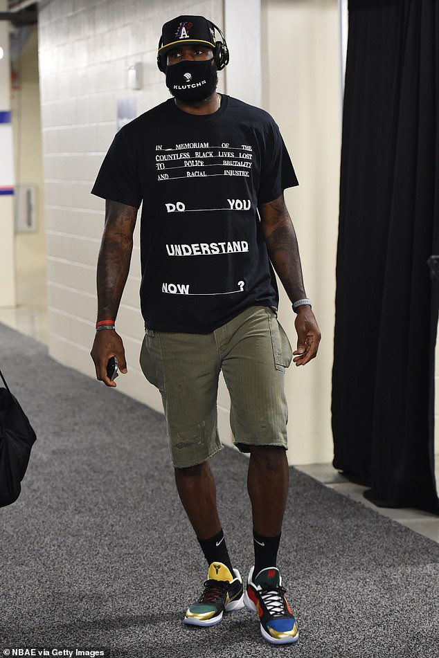 Safety first: The quadruple NBA MVP wore a face shield and shirt recognizing police brutality upon arriving at the arena.