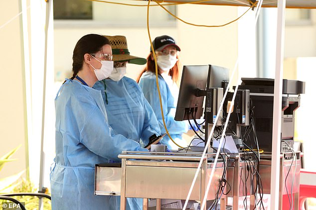 People work at a drive-through COVID-19 testing facility in Brisbane as the Sunshine State battles a new outbreak, similar to New Zealand