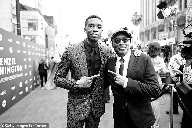 Tribute: Chadwick Boseman, left, has been hailed a 'trooper' by Spike Lee, right, who had no idea the star was battling cancer as he directed him in one of his final films. Pictured in 2019