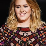 Adele shows off her VERY flat stomach in a halterneck bikini top after seven stone weight loss
