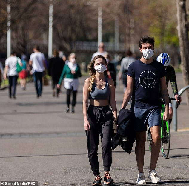 Restrictions in Melbourne are due to expire on September 13, but will be gradually reduced rather than removed altogether (pictured, the Melburnians out for a walk on Saturday)
