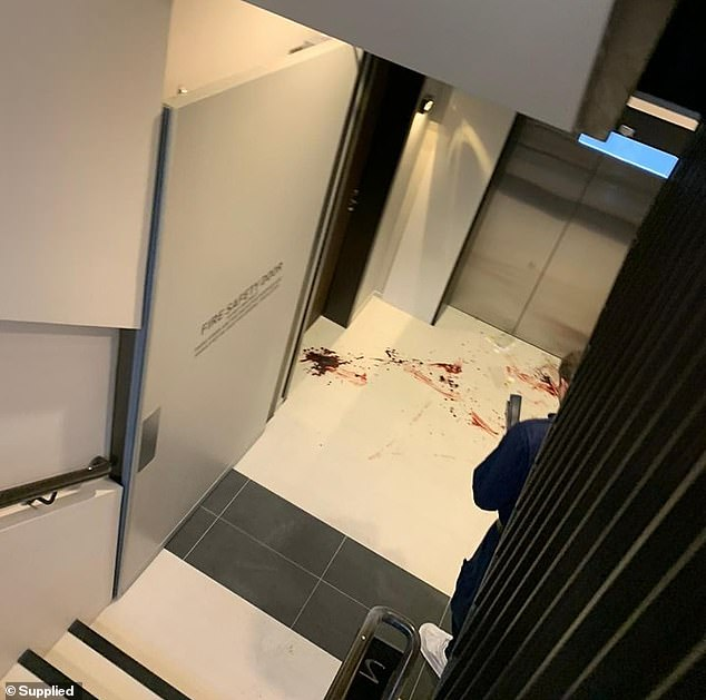The unit block (pictured) was splattered with blood after the alleged attack