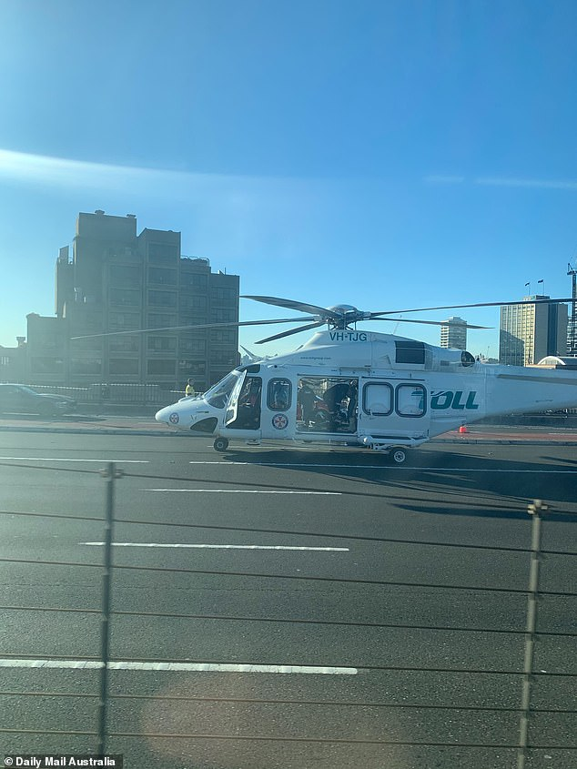 A helicopter landed on the bridge to to assist with transporting injured passengers to hospital