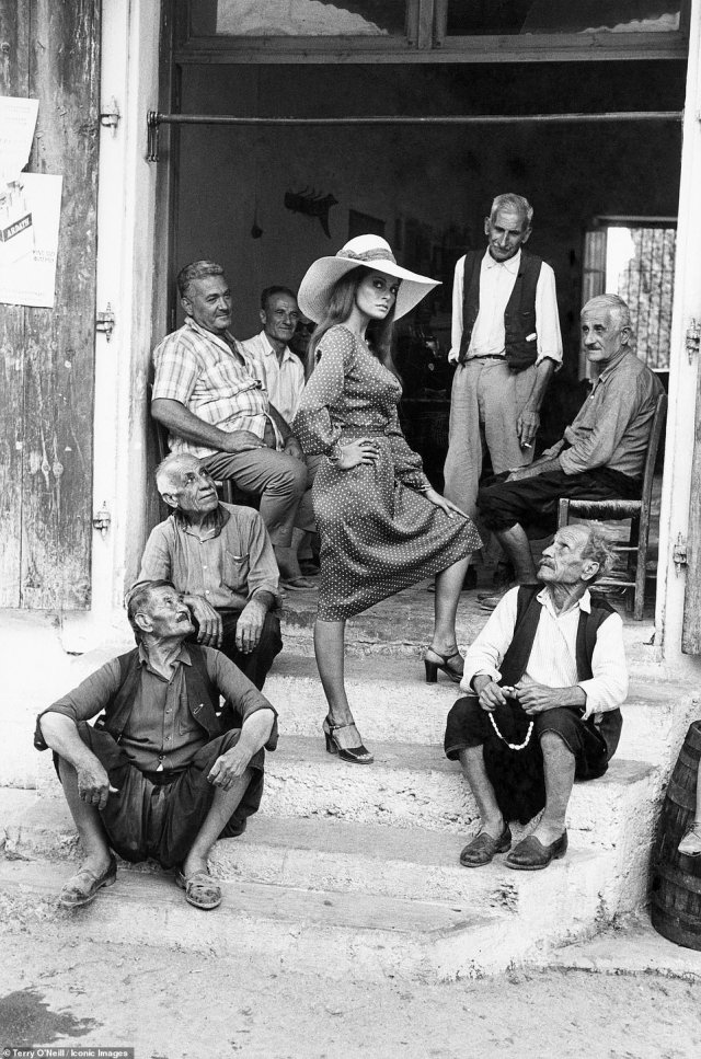 American actress Raquel Welch with a group of men on the set of the film 'The Beloved (aka Sin and Restless)' written and directed by George P. Cosmatos in Cyprus, 1970