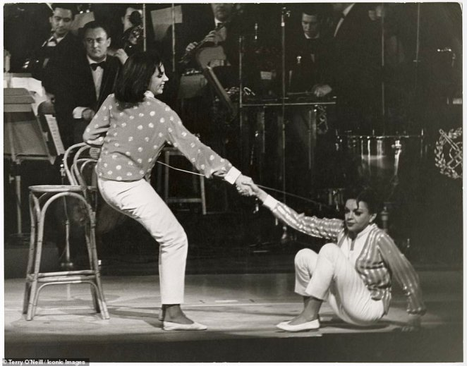 Other vintage images to go on display at the gallery includeAmerican actress' and singers Liza Minelli and Judy Garland performing at the London Palladium, 1964