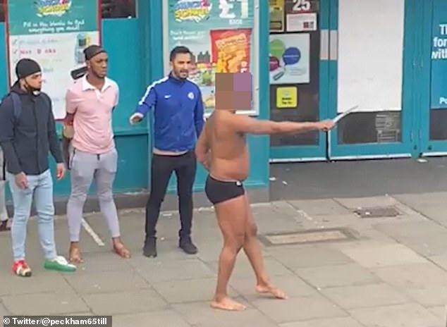 Shocking footage shows ahalf-naked man threatening shoppers with a large knife outside a Poundland in south London
