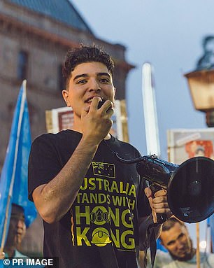 Pictured: 21-year-old student activist Drew Pavlou at a protest prior to his suspension