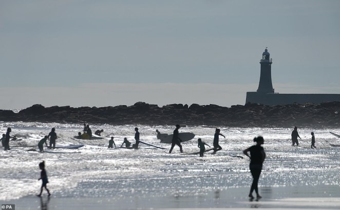 People take to the sea at Long Sands Beach in Tynemouth this morning as Brits wake up to the coldest late August bank holiday in 50 years