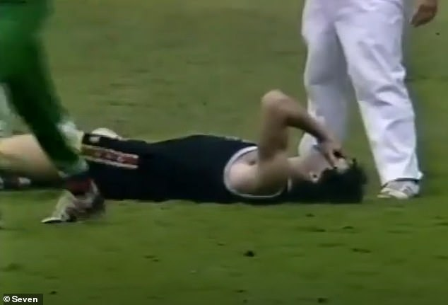 Frawley lies on the ground after copping a blow to the head during a match in the 1980s