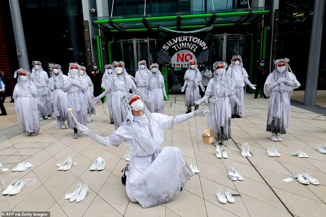 Outside Transport for London's headquarters, campaigners laid 26 pairs of shoes, 'one for each person who dies prematurely every day from air pollution in London'