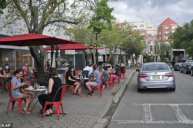 Governor Phil Murphy has announced that patrons can dine indoors again across the state from Friday. Restaurants and bars have only been allowed to offer outdoor seating after they could reopen in June. Pictured above is arestaurant in Montclair, New Jersey in July