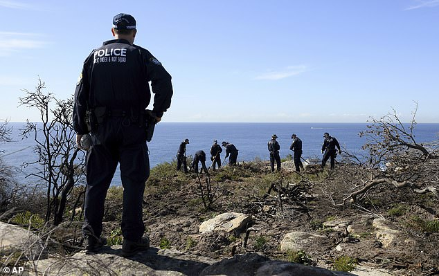 Pictured: Police search the headland near Manly following the arrest in connection to Scott's death