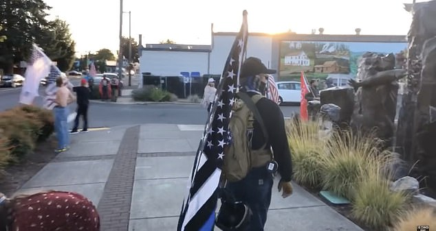 Footage showed members waving Trump 2020 banners, American flags and the Thin Blue Line flag as they stand next to roadways