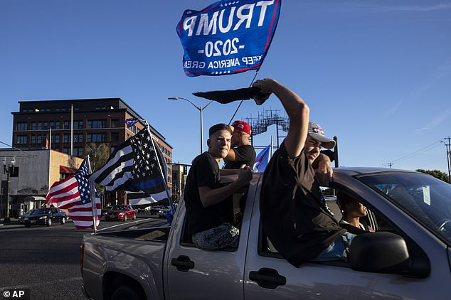The convoy numbered around 600 vehicles, with Trump supporters waving flags as they passed through Portland
