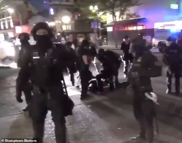The cops then formed a barrier around the man and asked the crowd what had happened