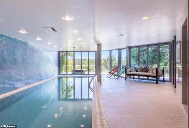 There is a fully heated salt water pool on one side of the lower ground floor as well as a cinema room anda home gym that leads to a decked terrace with a jacuzzi