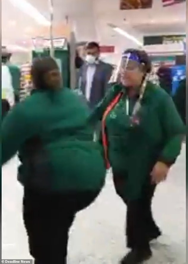 Morrison's employee (left) continues a long rant as she throws abuse at the customer as shocked onlookers watch