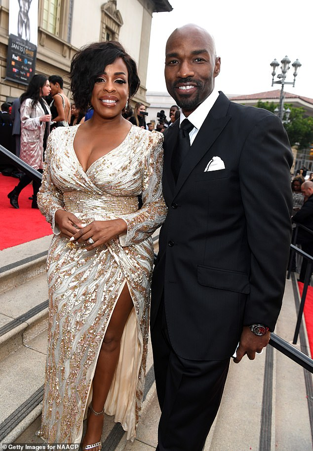 Happier days: Dividing assets: Her last marriage was to Jay Tucker; they wed in 2011 (pictured together September 2016). Niecy and Jay reportedly had issues over her role in Claws; seen in 2018 at the NAACP Image Awards at Pasadena Civic Auditorium