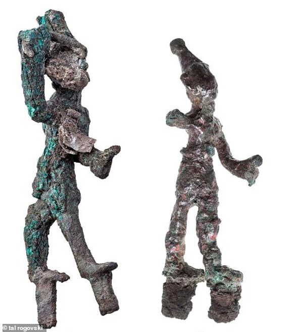 Two tiny Canaanite figures found in a 3,200-year-old temple in Israel.These figures were of either the god Baal or Resheph and are said to be 'smiting'