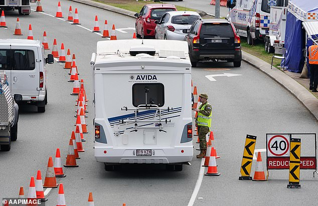 Motorists are stopped at a checkpoint in Coolangatta, on the Queensland-New South Wales border, when it was reintroduced in August