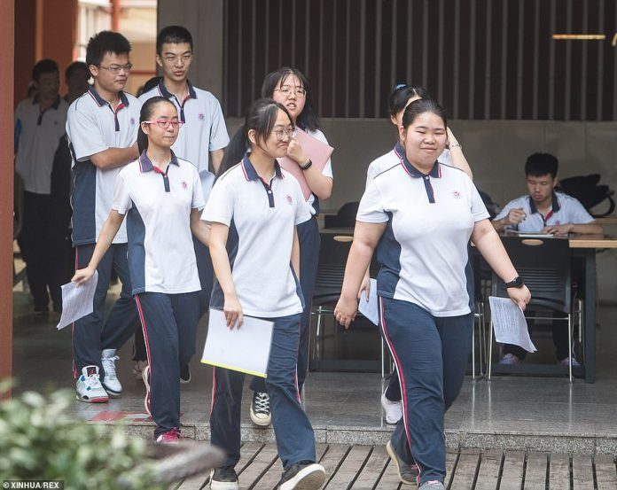 Students enter the Wuhan High School campus in Wuhan on September 1.  A total of 2,842 kindergartens, primary and secondary schools opened on Tuesday to accommodate around 1.4 million students in Wuhan City, Hubei