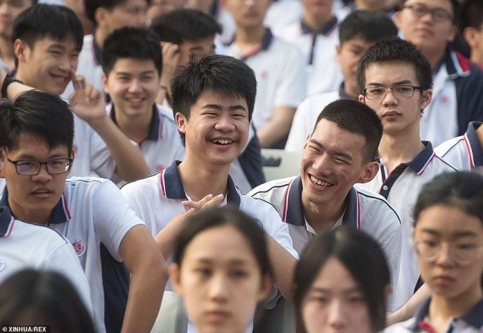 Students are seen gathering before the opening ceremony of a new semester at Wuhan High School in Wuhan on Tuesday