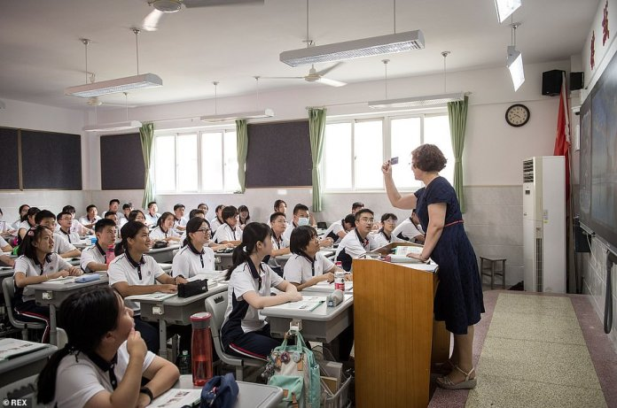A teacher is pictured speaking in a classroom at an elementary school in Wuhan City, central China's Hubei Province, Tuesday