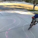 Man draws a race track on his drive for the bike-riding boy who keeps veering into his driveway