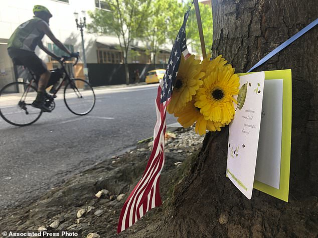 A small memorial to Portland, Oregon fatal shooting victim Aaron J. Danielson