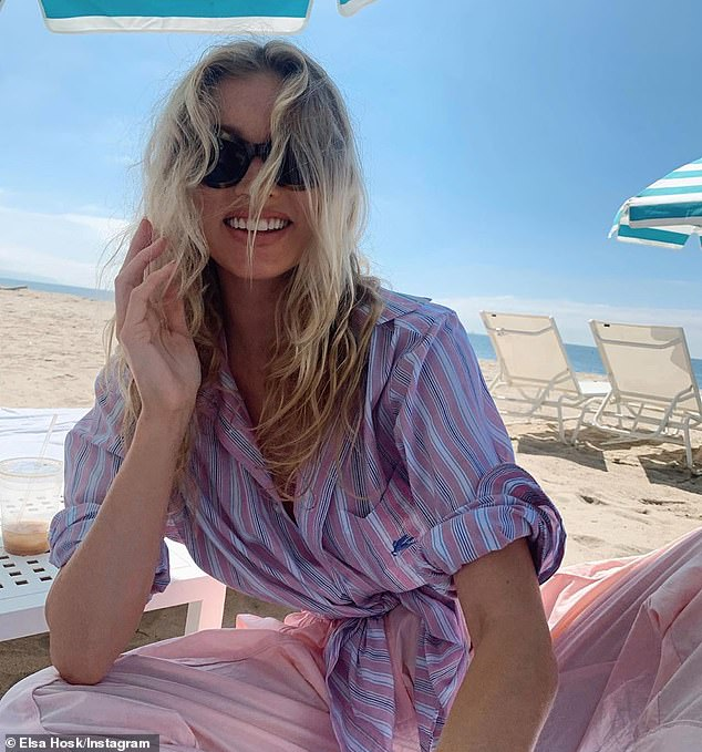 Beach glamour: The swedish stunner exudes beach luxury as she lounges on a beach chair with her blonde beach curls