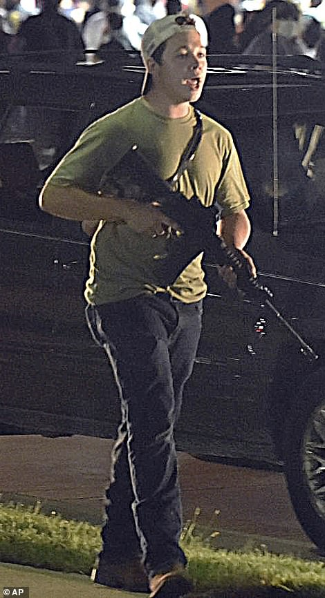 Kyle Rittenhouse, 17, was patrolling the streets with an AR-15. He fell over, was hit with a skateboard by other protesters who tried to disarm him, and opened fire, wounding one person and killing two. He is now being held on murder charges