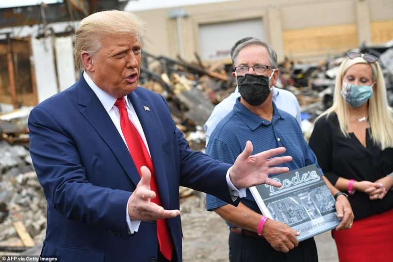 President Donald Trump tours some of the damage in Kenosha, Wisconsin on Tuesday, after state and city leaders asked him to stay away