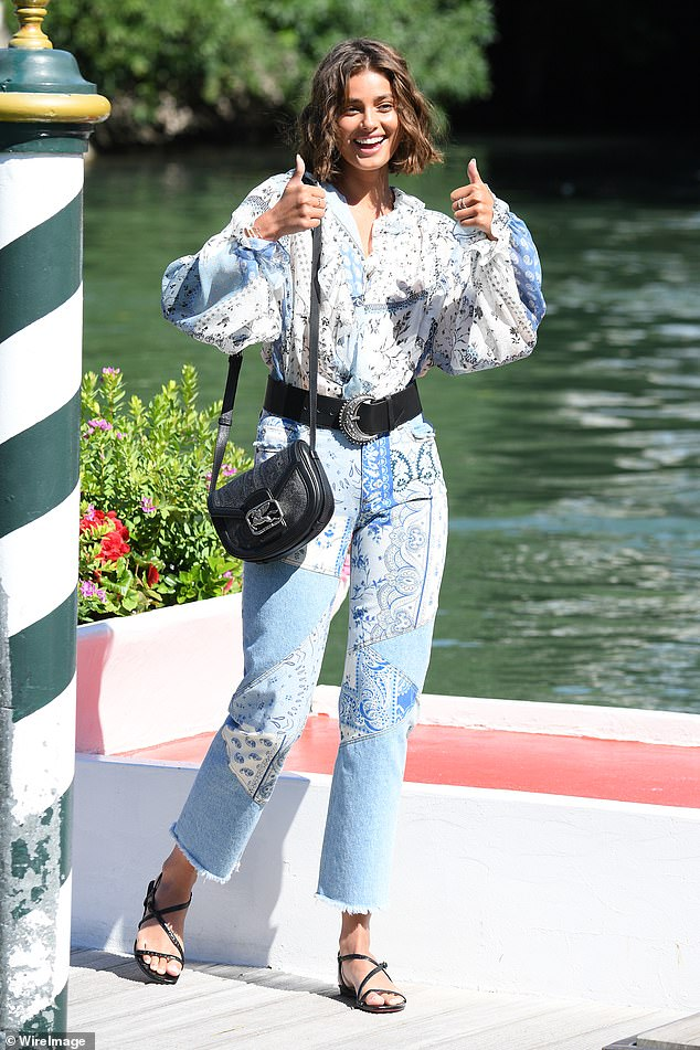 Taylor Hill looks sensational in a clashing-print denim jumpsuit at the 77th Venice Film Festival