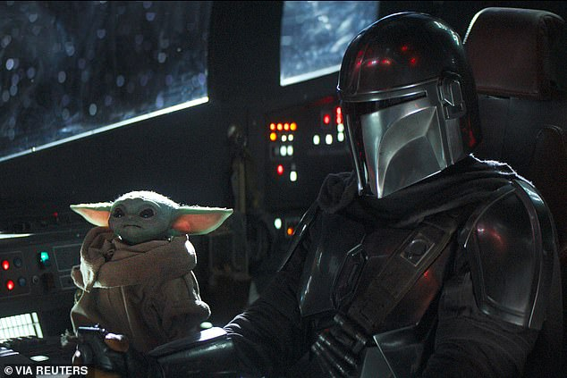 More to come:The second season of the smash hit Star Wars series The Mandalorian has landed a release date on Disney+; Pedro Pascal, right, with Baby Yoda, left
