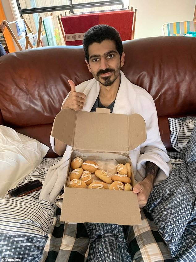 Pictured: Ben Stylo with a box of baked good sent from his grandmother earlier in 2020
