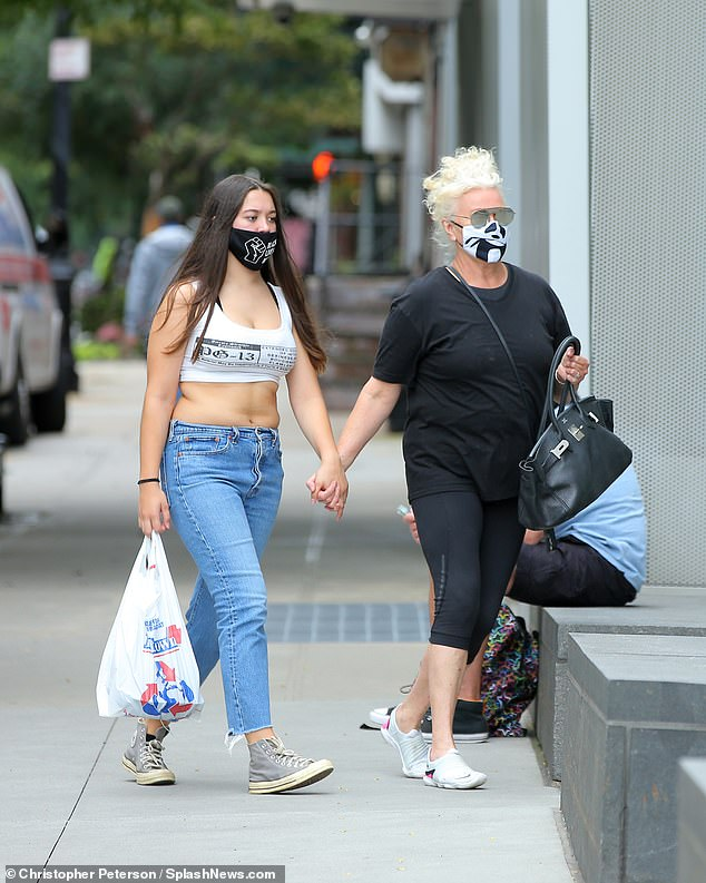 Safety first:Australian actress Deborra-Lee Furness and her daughter Ava, 15, wore masks and held hands as they picked up lunch for their family in New York on Wednesday (both pictured)