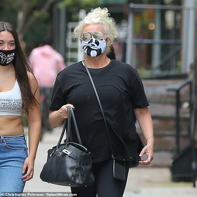 Style:The wife of hunky Wolverine star Hugh Jackman wore a black and white ensemble, consisting of dark three-quarter length pants, a short-sleeved t-shirt and sneakers