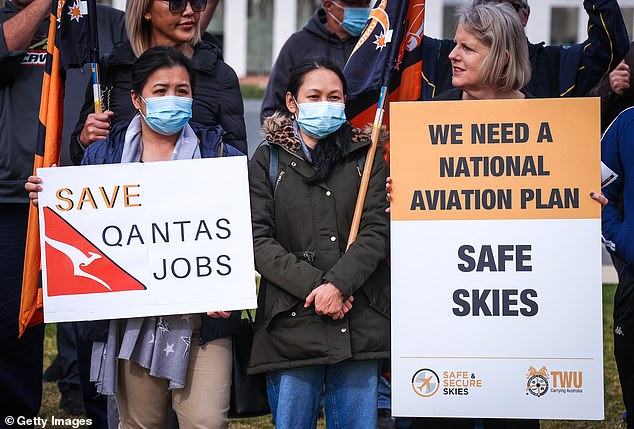 The tourism industry is terrified that Mark McGowan, who is fiercely popular in the polls, will keep the WA border shut until after the state election on 13 March. Pictured: Qantas workers protest in Canberra after losing their jobs