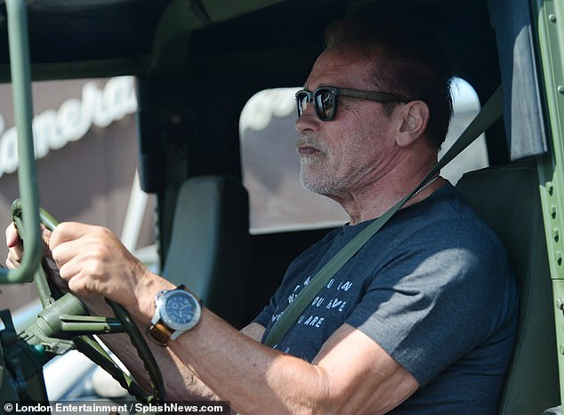 Focused: The A-list action star kept on a pair of shades and a watch on the outing
