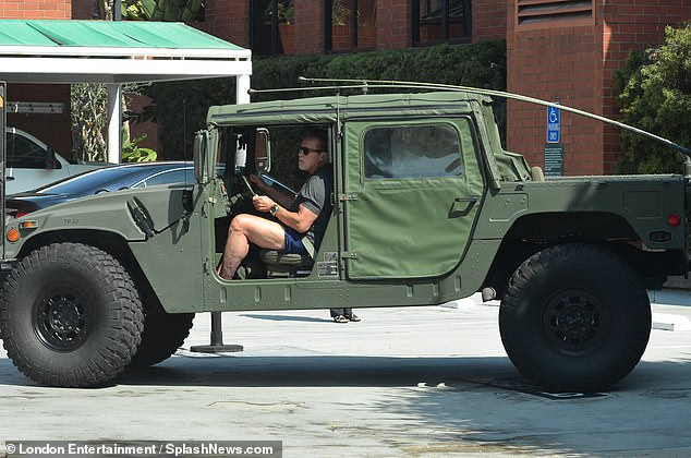 Out and about: Schwarzenegger began the new month in a green hummer he was seen riding in Los Angeles
