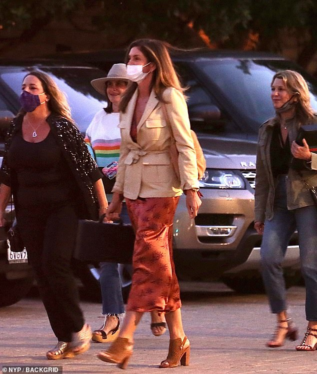 On the town: Cindy Crawford, 54, looked chic in a tan safari jacket as she arrived at the swanky Japanese restaurant Nobu Malibu on Wednesday for a night out with her girlfriends