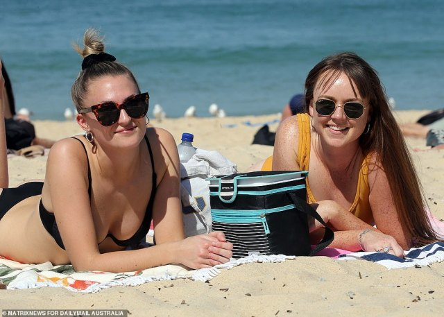 Further along the beach lounging in the sun were housemates Zoe Martin, 24, and Emma Byden, 26, they felt everyone was social distancing on Thursday