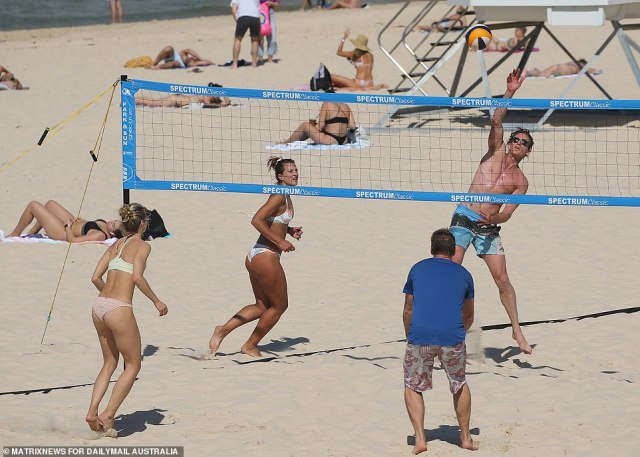 Volleyball players are seen at Bondi Beach on Thursday afternoon as the mercury soared to a scorching 29C