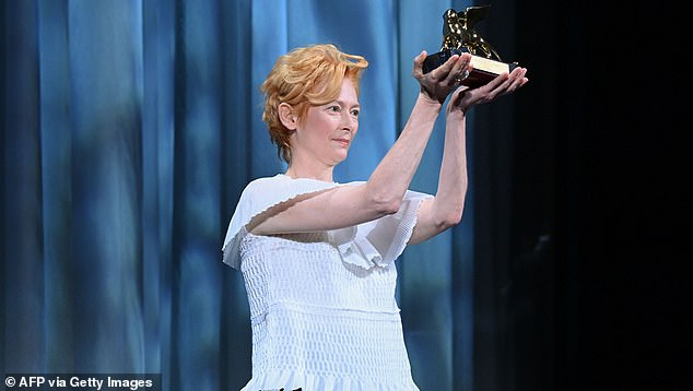 Winner! Tilda, whose first screen appearance was in Caravaggio in 1986, held up the prestigious award on stage