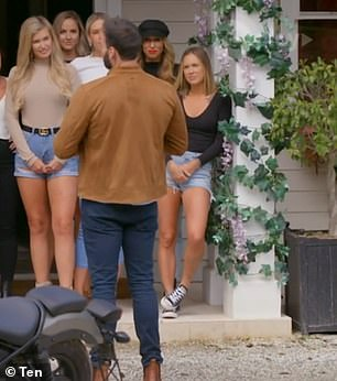 Oops: The Bachelor suffered a major editing fail during Wednesday's episode, with hopeful Roxi Kenny inexplicably seen in two different outfits during the same scene. Pictured in denim shorts (far right)