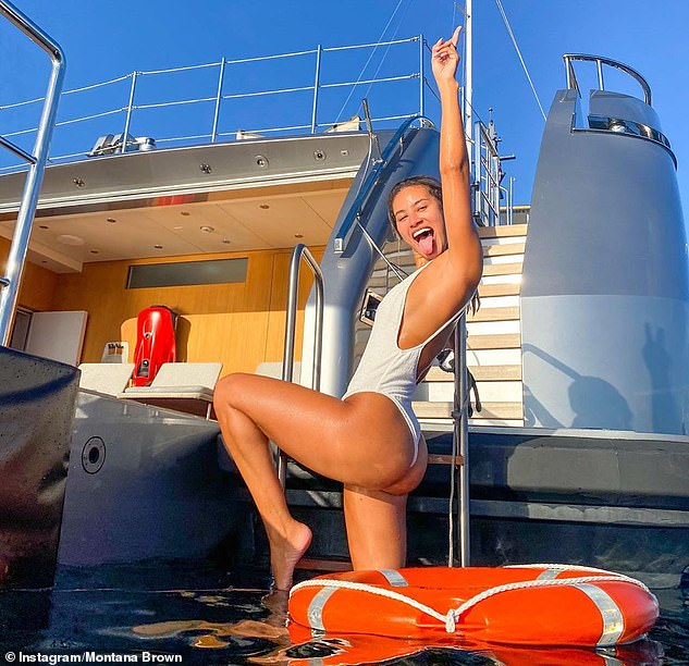 Fun in the sun:Montana Brown sent temperatures soaring as she slipped into a plunging white swimsuit while enjoying a boat trip during her trip to Italy on Wednesday