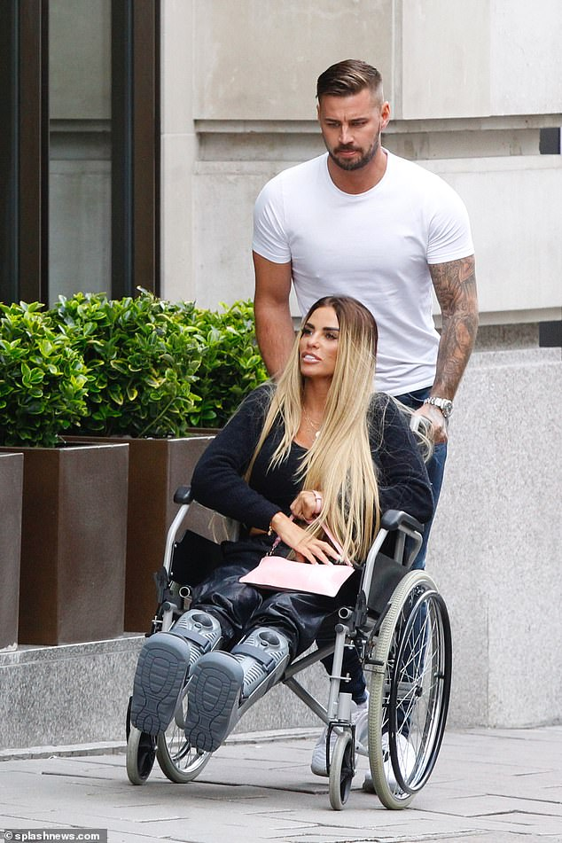The happy couple:Katie Price was seen enjoying a lunch date with her Love Island star boyfriend Carl Woods at Mayfair's swanky Novikov restaurant on Tuesday