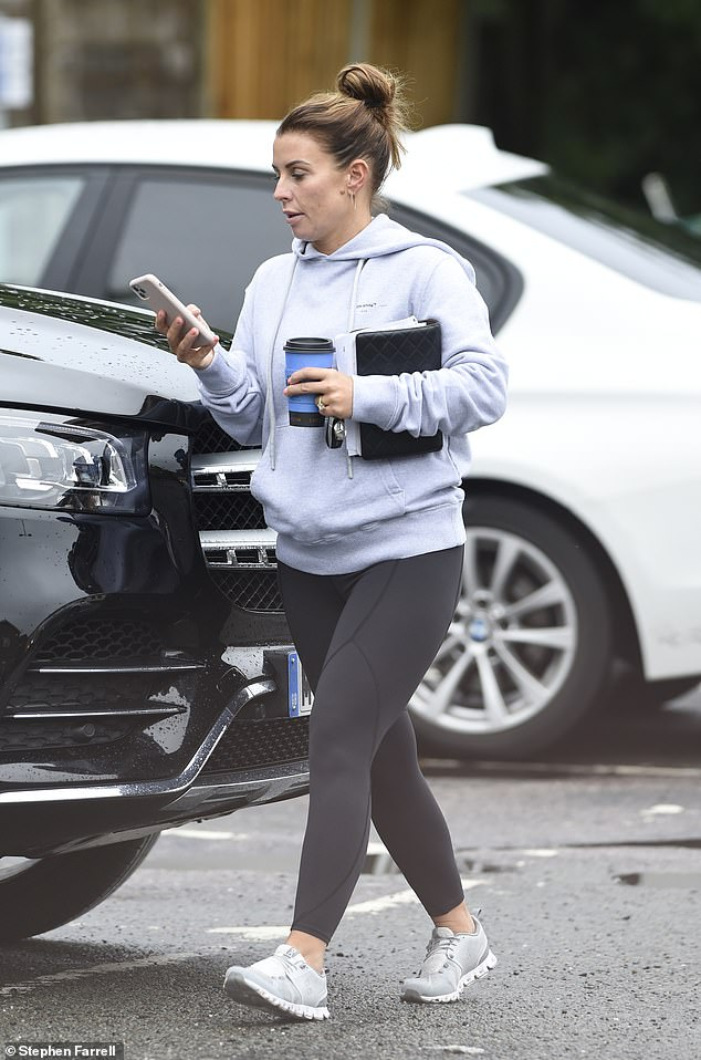 On call: The mother-of-four appeared distracted as she gazed down at her phone while heading back to her car