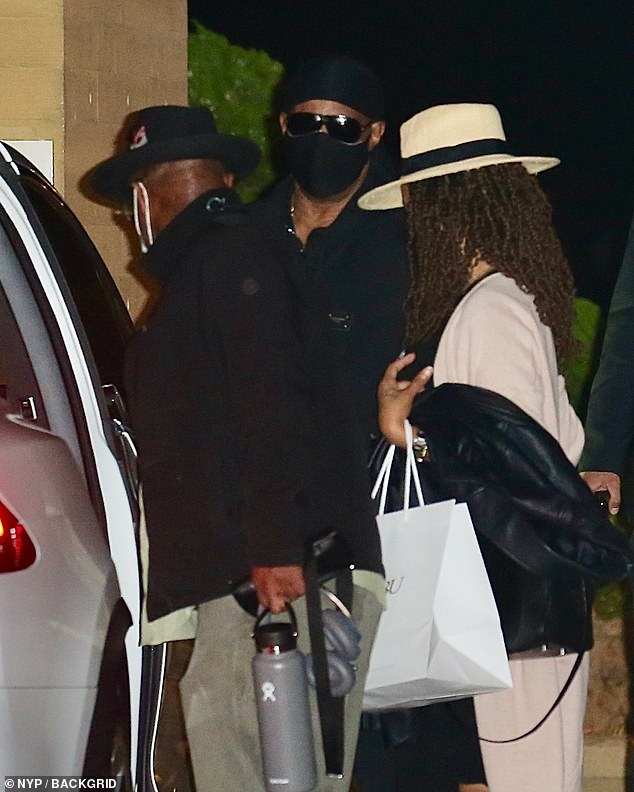 You Are The Sunshine Of My Life: Stevie Wonder, 70, (centre) was pictured leaving dinner at Nobu in Malibu on Wednesday after celebrating his son Kailand's 19th birthday