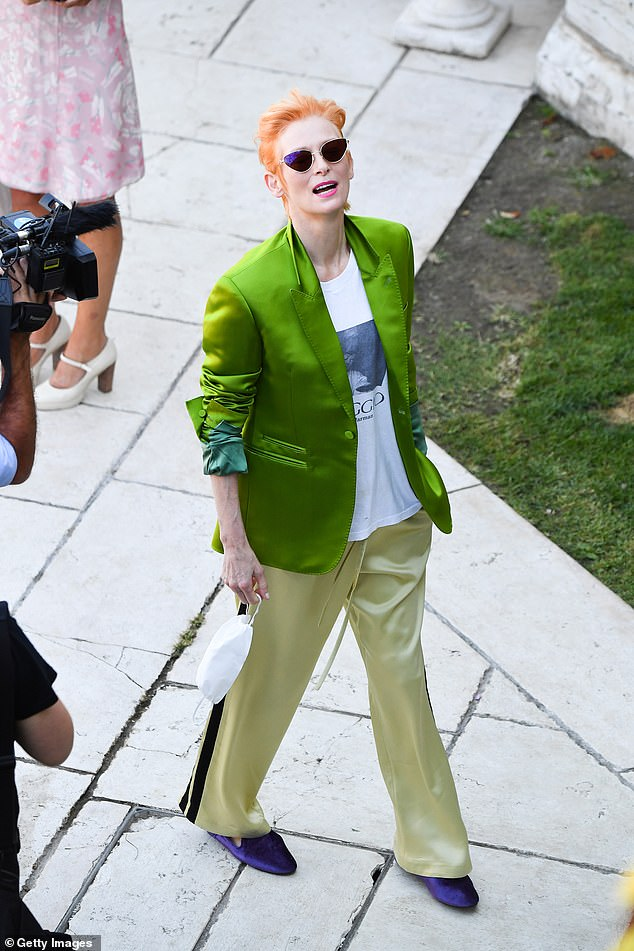 Star style:Earlier on Thursday Tilda again showed off her signature quirky fashion sense in a lime green jacket as she departed her hotel for her day of press
